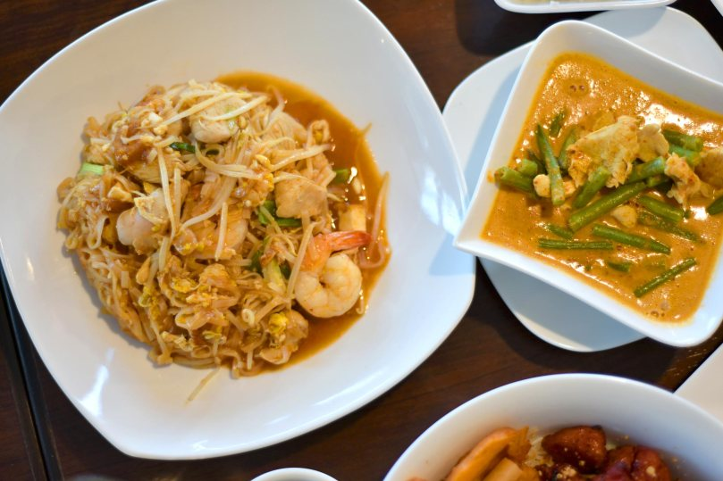 Pad Thai $10.99, Golden Curry $9.95, Coconut Rice $1.75